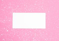 Styled feminine flat lay on pale pastel pink background, top view. Minimal woman`s desktop with blank page mock up, open envelope stock photo