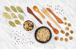 Styled food ingredients and utensils on marble background royalty free stock photo
