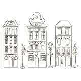 Styled houses and street lamps. Set of three silhouette of old european houses and three street lanterns. Stylized freehand drawn picture. on white. Romantic stock illustration