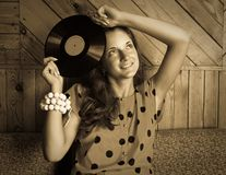 Styled lady with  vinyl plate Royalty Free Stock Photography