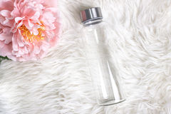 Styled mockup of clear plain glass water bottle. Stock Image