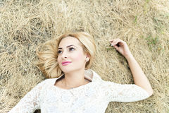 Styled portrait of beautiful young woman in the hay Royalty Free Stock Photography