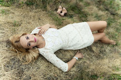 Styled portrait of beautiful young woman in the hay Royalty Free Stock Image
