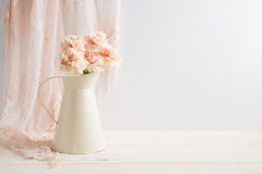Styled stock image of carnations in a cream jug Stock Photos