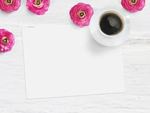 Styled stock photo. Feminine product mockup with buttercup flowers, Ranunculus, blank list of paper, cup of coffee and. Shabby white background. Flat lay, top Stock Photography
