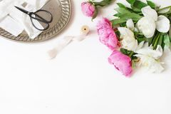 Styled stock photo. Feminine wedding or birthday table composition with floral bouquet. White and pink peonies flowers. Old vintage scissors, silver tray and royalty free stock photo