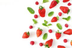Styled stock photo. Summer healthy fruit composition with red strawberries, raspberries, fresh green mint leaves. Isolated on white table background, ood Stock Photo