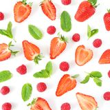 Styled stock photo. Summer healthy fruit composition with sliced strawberries, raspberries, fresh green mint leaves. Isolated on white wooden table background Stock Photo