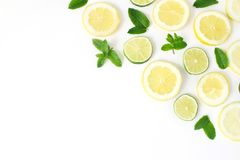 Styled stock photo. Summer herbs and fruit composition. Lime, lemon slices and fresh green mint leaves isolated on white. Table background. Juicy food pattern royalty free stock images