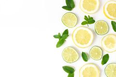 Styled stock photo. Summer herbs and fruit composition. Lime, lemon slices and fresh green mint leaves isolated on white. Table background. Juicy food pattern stock images