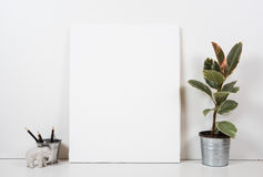 Styled tabletop, empty frame, painting art poster interior mock- Stock Photos