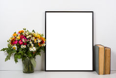 Styled tabletop, empty frame, painting art poster interior mock- Royalty Free Stock Image