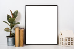Styled tabletop, empty frame, painting art poster interior mock- Stock Images
