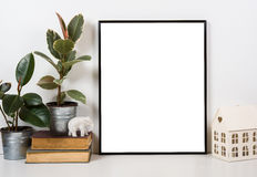 Styled tabletop, empty frame, painting art poster interior mock- Stock Photography