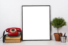 Styled tabletop, empty frame, painting art poster interior mock- Stock Image