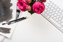 Styled tabletop mockup, computer keyboard and pink flowers on wh Stock Images