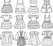 Styles de diverses robes pour de petites filles Photographie stock