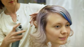 Styling a client`s hair in beauty salon, stock video footage