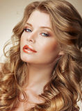 Styling. Gorgeous Fashion Model with Perfect Light Silky Hair Stock Photo