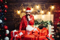 Styling man with a long beard posing on the wooden background. Christmas santa wishes merry christmas. Hipster santa. Claus stock photos
