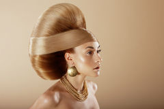 Styling. Profile of Glamorous Woman with Golden Hairdo Stock Photos