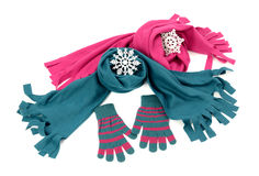 Styling a scarf with matching gloves. Pink and blue wool scarves nicely arranged. Winter accessories isolated on white background Royalty Free Stock Image