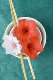 Styling series; rice bowl and flowers, top view Stock Photos