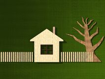 Stylingwooden  house. Styling house with a fence in the grass Royalty Free Stock Image