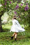 Stylis Happy Girl Dancing In The  Lilac Garden Stock Photos