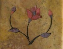 Stylised flower inlaid on stone Royalty Free Stock Photo