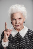 Stylish adult female seriously looking at camera Stock Image