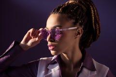 Stylish african american girl posing in purple sunglasses, Stock Photos