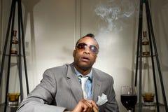 A stylish african american smoking his ciga Stock Photos