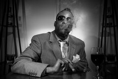 A stylish african american smoking his cigar Royalty Free Stock Photo
