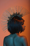 Stylish african american woman in gorgeous headpiece with needles. Rear view of stylish african american woman in gorgeous headpiece with needles Stock Images