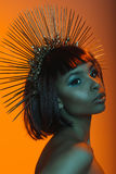 Stylish african american woman posing in headpiece with needles Royalty Free Stock Images