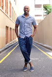 Stylish african man standing in the city. Portrait of stylish african man standing in the city Stock Image