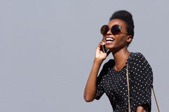 Stylish african woman talking on cellphone Royalty Free Stock Photo