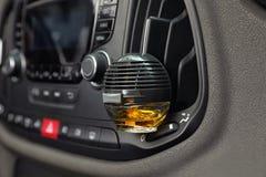 Stylish air freshener hanging. Near car ventilation royalty free stock photo