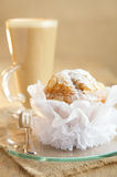 Stylish almond muffin and coffee latte Stock Image