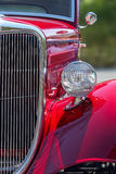 Stylish American hot rod in candy apple red, front view details Stock Photography