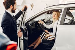 Free Stylish And Elegant Woman In A Car Salon Stock Image - 161046331