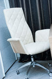 Stylish armchair. Beautiful modern white armchair made of leather Stock Photography