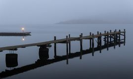 Stylish art pier in fog. Stylish art picture, pier in fog, monochrome, dark an moody, calm with clear reflections, from Särö, Sweden stock photos
