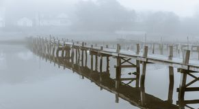 Stylish art pier in fog. Stylish art picture, pier in fog, monochrome, moody, calm with clear reflections, from Särö, Sweden royalty free stock photography