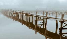 Stylish art pier in fog. Stylish art picture, pier in fog, monochrome, moody, calm with clear reflections, from Särö, Sweden stock photo