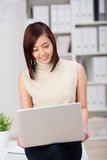 Stylish Asian businesswoman at work Stock Photography