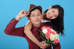 Stylish Asian teen couple pose and smile Royalty Free Stock Image