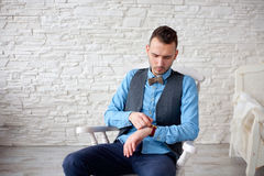 Stylish attractive man sitting in a chair Royalty Free Stock Photography