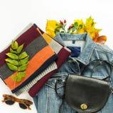 Stylish autumn look. Autumn fashion, woman autumn outfit on white background. Blue denim jacket , retro sunglasses, black crossbod. Y bag, stripe scarf. Flat lay Stock Images